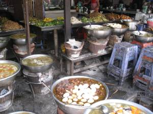 An array of Khmer entrees for sale at the local market