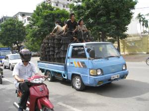 Driving down Phnom Penh I saw this truck loaded to the max with metal brackets AND people