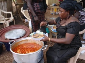 Fufu being served with stew and meat