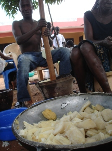 Each piece of cassava in the bowl gets pounded one at a time