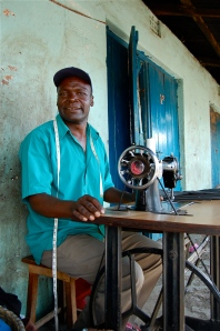 Bernard, Kiva Borrower, lost his business during post-election violence last year when his sewing machine was stolen. He fled the area for months, then returned to start again, buying a new machine with a K-MET loan
