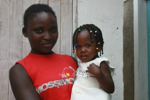 A Sisterhood for Change participant posing with her child