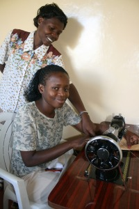 Susan teaches tailoring skills to an SFC girl