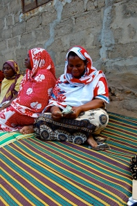 A BRAC Tanzania borrower makes a loan repayment in Zanzibar