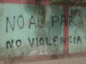 """No to the strike, no violence."" Similar graffiti was all over Pucallpa."