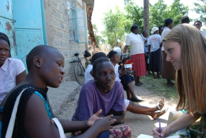 Alison (right) interviewing Consolata (center), with help of K-MET translator, Debra (left)
