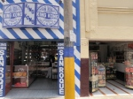 An endless stretch of candy shops on Bolognesi selling King Kong*
