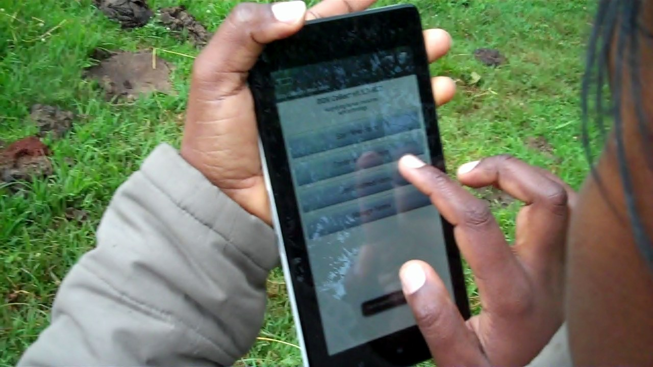Juhudi loan officer using mobile app to capture Kiva profile info