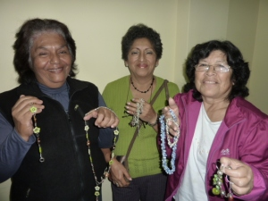 Carmen, Maria and Lina proudly show their bijouterie products