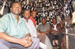 6) Thika Branch - SMEP Borrower Cyrus (3rd from Left) and his group - added more ladies shoes to his inventory
