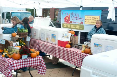 a well established farmers market stall with professional signage