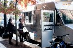 an expensive food cart giving samples to attract customers