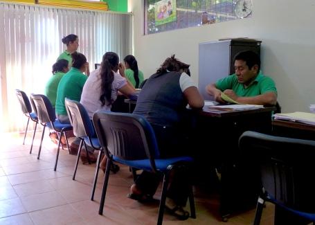 Busy With Borrowers: Emprender loan officers in Santa Cruz working the room