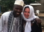 Holly and Kamal are dressed to prayer