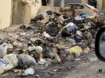 Solid waste problem in the neighborhood of a Tamweelcom microfinance client