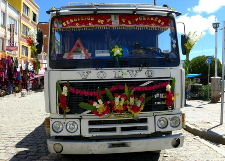 Bolivian delivery truck bedecked with blessings for the dangerous mountain roads