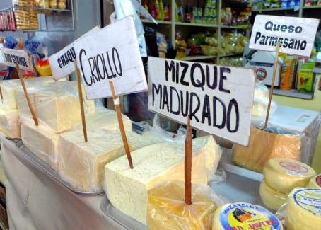 Locally produced quesillo cheeses for sale in Cochabamba markets, products that help dairy farmers earn extra income.