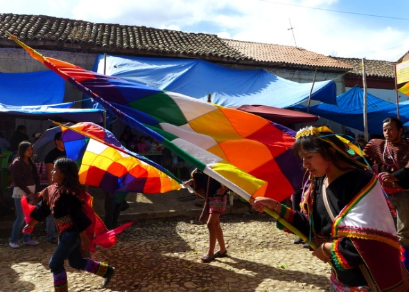Proudly marching with the <em>Wiphala:</em> This Andean flag is eons old but only recently became official in Bolivia