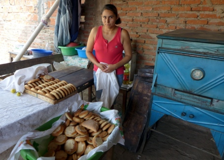 Señora Yélica at home with her Kiva-funded oven