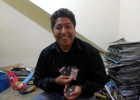 Señor Gustavo eagerly shows off his Kiva-funded magic kits