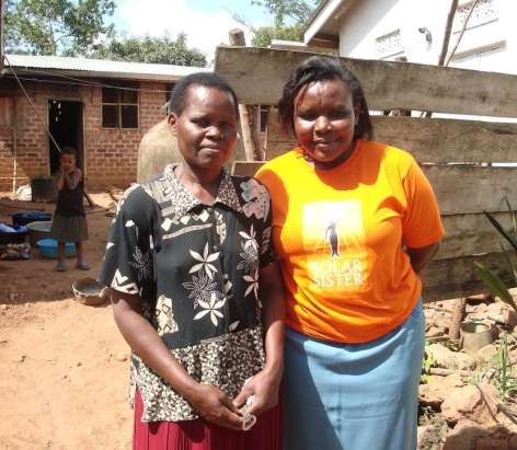Solar Sister Entrepreneur Florence and her happy customer, Agnes