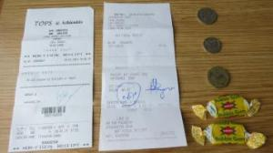 South African Rand and Botswanian Pulsa coins, bubble gum and credit receipts for grocery stores