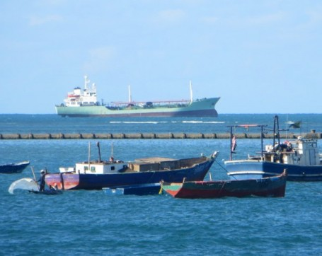 Container ship and fishing boats juxtaposed at the mouth of Dar es Salaam's famous harbor.