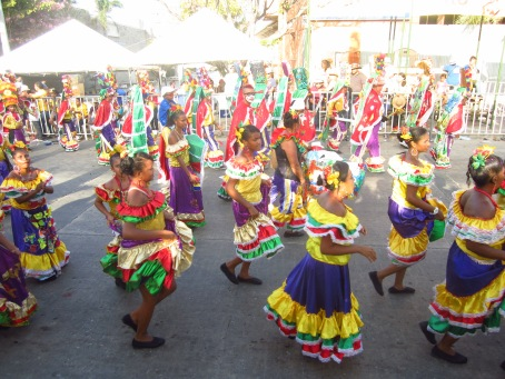 Dancers in colorful costumes during the Gran Parada de la Tradición, one of many parades throughout Carnaval