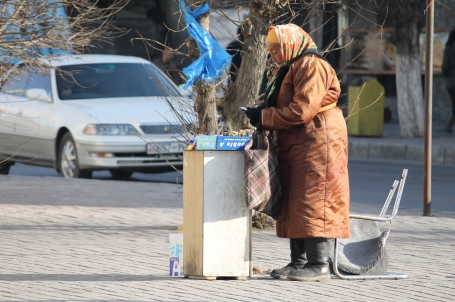 an elderly lady I often see selling gum and candy on the street, even on the coldest winter days