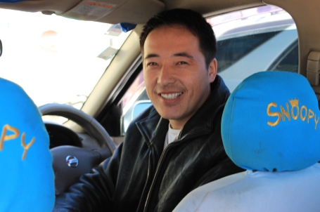 Batbileg, a taxi driver, in the car he purchased with the help of his loan