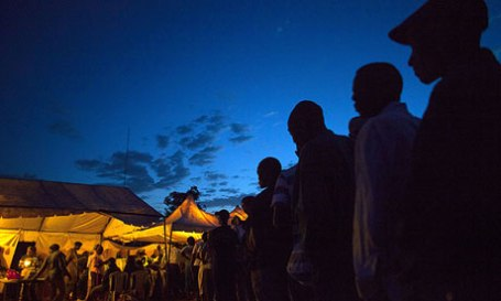 Kenyans queue at a polling station in the Nairobi slum of Kibera, the biggest in Africa.