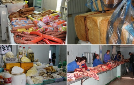 the food market in Sukhbaatar, selling (clockwise from top left): a) a selection of meats and sausages, b) huge loaves of bread, c) farm fresh meat, d) an assortment of dairy products, including fresh milk and various forms of curds