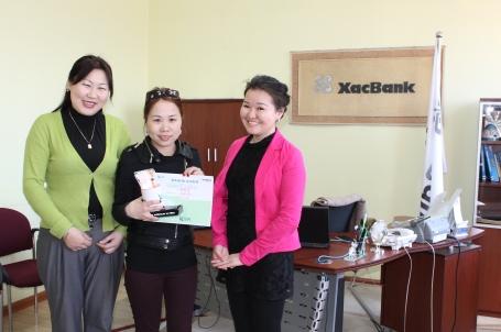 rewarding a borrower through XacBank's 9% savings incentive program