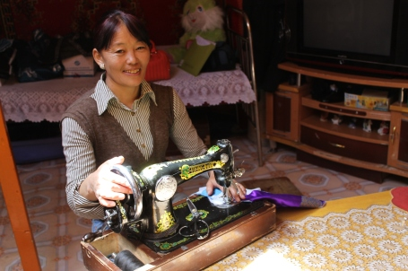 Gerelmandah is a tailor who takes custom orders to make beautiful traditional Mongolian clothing, such as deels (below). It's a trade that was passed on to her by her mother, and one which she is now passing on to her own daughter.