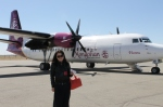a typical plane which carries private messages across Mongolia... and a typical messenger who delivers the service